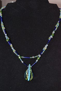 Pic 2...Green, Clear and multi Blue double strand with pendant.  Same necklace-two ways to wear