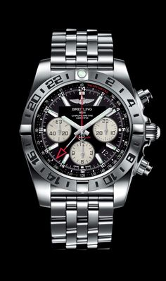NEW Chronomat 44 GMT traveler's watch by Breitling - Steel case, onyx black dial, steel Pilot bracelet.