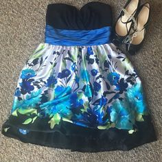 Gorgeous Blue & Black Strapless Dress Blue & Black are in this year! Such a beautiful way to pull it off! I love this float skirt and the beautiful floral pattern to it. Trixxi Dresses Strapless