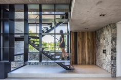 Image 2 of 24 from gallery of Sukkha House / OON Architecture. Photograph by Alejandro Peral Architecture Photo, Residential Architecture, Board Formed Concrete, Rustic Master Bathroom, Geometric Pendant Light, Modern Bathtub, Internal Courtyard, Black And White Tiles, House Built