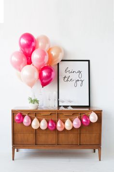Hot pink and peach balloons perfect for baby girl showers, gender reveals and fun to be one 1st parties. Designed by Luft Balloons in Chicago.