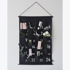 """DESCRIPTION Design Letters Limited Edition advent calendar featuring 24 small pockets to countdown the holiday! Wrapped in a beautiful gift box. Final Sale Item19.6"""" x 29.5"""" DESIGNER Ferm Living"""