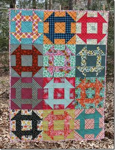"Very colorful Potluck Churn Dash quilt made by Jamie Lee from Busy Bee Quilts. ""The quilting is a criss-cross on the diagonal—I marked it with masking tape and used 50 wt. pink Aurifil thread.""    To see more visit  http://thebusybeequiltshop.blogspot.com/2013/04/potluck-churn-dash.html"