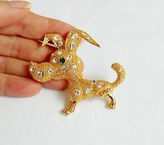 Vintage Rhinestone Gold Dog Pin , Prancing Puppy Dog Brooch with Emerald Green Rhinestone Eye by PrettyShinyThings4U on Etsy