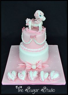 Rocking horse christening cake. Pink frills, gingham bows, heart pillows and a rocking horse. How much more girly can you get?!