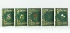 Five volumes, all first editions. 8vo. Original green cloth elaborately decorated in gilt and black with a different hand painted flower to the front cover of each volume.  Each volume housed in its original cloth covered card box with printed paper label to the upper cover.