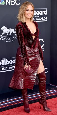 Jennifer Lopez played with texture in a burgundy Roberto Cavalli look styled with over-the-knee…… - #jlo