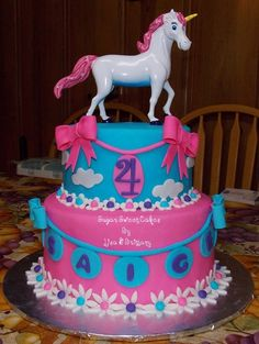 Pink & Blue Unicorn Cake- Lily is in love with this and wants me to make for her b-day. Good luck with that happening!