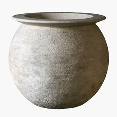 Form and texture lend visual interest to this unique round planter made from cast stone. For tribal, natural, or contemporary decor indoors or outdoors.