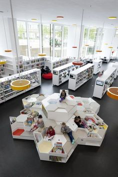 Such cool seating, and oh that natural light! Ørestad School And Library | STAMERS KONTOR