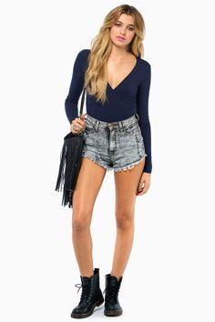High waisted denim + a cool long sleeved top