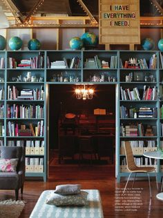 Blue bookcase wall with globes