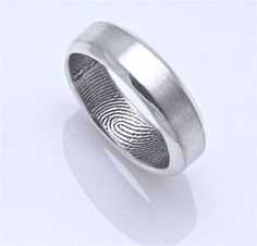 such a cool wedding band for a guy (with the bride's finger print inside) - so sweet