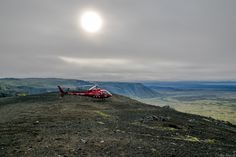 A shot of the helicopter landed on top of a mountain with the setting sun in the background.  A shot of the dark and rough looking terrain that made up the volcanic mountain range just outside of Reykjavik, Iceland.  || #AlexTonettiPhotography #Photography