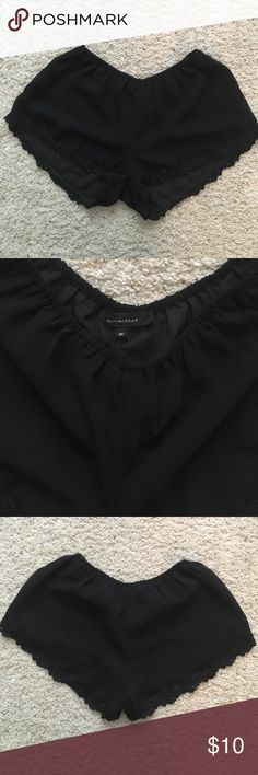 Flirty black lace trimmed shorts Black lace trimmed shorty shorts Olivaceous Shorts