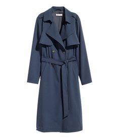 Dark blue. Double-breasted trenchcoat in woven fabric with a collar and wide…