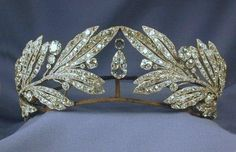 Princess Marie Bonapart Tiara, Cartier, 1907 The tiara consists of twin pave set diamond olive branches meeting at a pear shaped diamond in ...