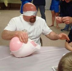Pin a diaper on a balloon without popping it, while you are blind folded! What FuNn..