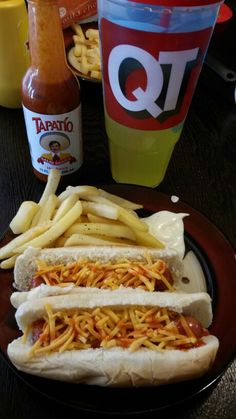 "Turkey hot dogs . With ranch cheese & tapatio sauce . With a side of french frys and ranch . & Gatorade  ""lemon lime""  to drink"