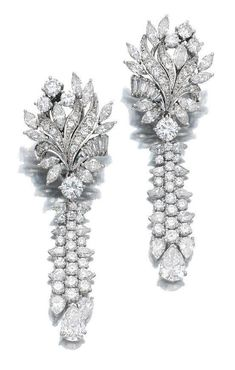 PAIR OF DIAMOND PENDENT EARRINGS. Each earring featuring a surmount of floral design suspending a tassel motif, set with marquise-, pear-shaped, brilliant-cut and baguette diamonds, post fittings I Love Jewelry, Fine Jewelry, Jewelry Design, Cheap Jewelry, Jewellery, Jewelry Rings, Antique Jewelry, Vintage Jewelry, Silver Jewelry