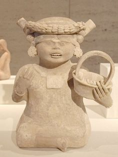 Smiling Girl Holding a basket Mexico, central Veracruz, Nopiloa style, Late Classic period (A.D. 600–900)