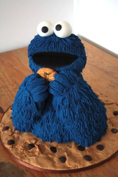 Cookie Monster Cake ~ 5' and 6' round cake with RKT head and arms.  Covered in Blue fondant pushed through an extruder.