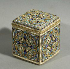 LIUBAVIN ANTIQUE RUSSIAN SILVER-GILT AND CLOISONNE AND PLIQUE-A-JOUR ENAMEL COVERED BOX, HALLMARK OF ALEKSANDER BENEDICTOVICH LIUBAVIN, ST. PETERSBURG, CIRCA 1896-1903 Square box with a hinged cover, overall decorated in a foliate motif with opaquec and translucent enamel in shades of blue, green, red, yellow and white.