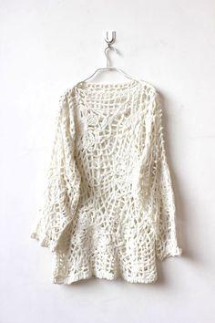 pierced white jumper