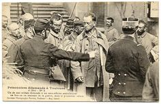 "France. Leave My Buttons Alone,  ""German prisoners at Toulouse. One of our soldiers asks an ambulance 'subofficer' for a button as a souvenir of the war, but the prisoner refuses"".WWI, Toulouse, 1914 