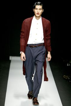 This outfit by Vivienne Westwood is very similar to that of a man wearing a Zoot Suit from the 1930s. The long coat, baggy pants, and button up shirt are clear indicators that this ensemble is inspired by this time period. 2/28/15