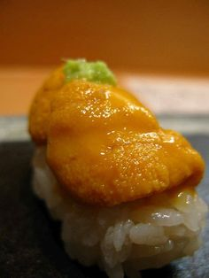 Japanese Food Uni Nigirizushi, Creamy Sea Urchin Sushi.                                    I'll try anything once. One time only for this.