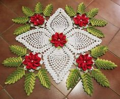 Beautiful colored crochet doily . . . i really love the flowers and leaves on this one, and the unique pineapple center.
