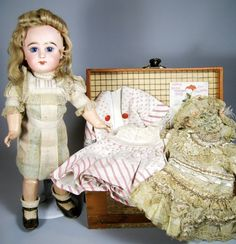 French Bebe Jumeau in original dress with wardrobe