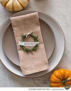 Place Card rosemary wreath w name scroll. Not practical, but pretty.