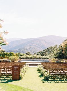 This scenic wedding aisle almost doesn't look real. We must say that the mountains and the greenery make for perfect ceremony décor. Wedding Aisles, Walking Down The Aisle, Ceremony Decorations, Flower Petals, Weddingideas, Floral Arrangements, Greenery, Orchids, Dolores Park