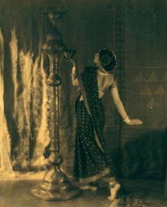 ruth st denis in bakawali posed in sari holding object