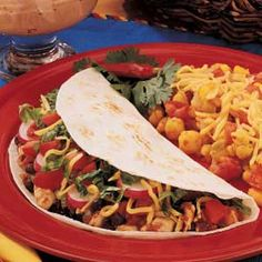 Soft Chicken Tacos:  6 servings; 1 taco (calculate without toppings) equals 271 calories, 2 g fat; Diabetic Exchanges:  2-1/2 starch, 2 lean meat