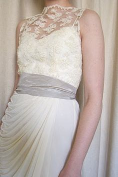 Thrift store dress. Arms cut off & hem taken up. Sash added to make less wedding'ish
