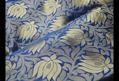 This is a beautiful pure benarse silk brocade floral design fabric in Blue and Gold. The fabric illustrate golden woven lotus flower on blue background.  You can use this fabric to make Dresses,...