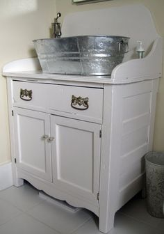 Metal tub as sink??  I love this sink and vanity combo...