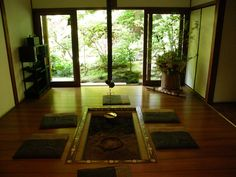 Sukiya living. In traditional Japanese interiors the furnitures are not placed against the walls of a space. The 'living' finds place in the centre of the room where the furniture  Is placed.