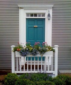 Medium gray house with dark turquoise door. You could have flower boxes hanging over the backsides of your two benches!