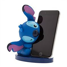 Stitch MXYZ Phone Stand | Disney Store Stitch has great taste in phone stands, as he shows with this figural vinyl version in which he grips your phone in his mouth. Now you won't have any trouble finding your phone, although it might not be so easy getting it away from Stitch.