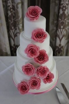Rebecca: 4-tier White Wedding Cake with Coral Pink Handmade Sugar Roses and piped pearl details