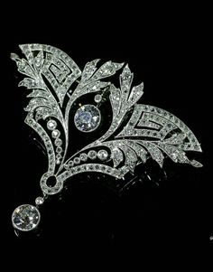 An Art Deco platinum and diamond brooch / pendant, French, 1920-30. With meander and foliate motifs, set with old European and rose-cut diamonds, mounted in platinum. #ArtDeco #pendant #brooch