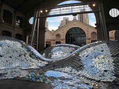 Waste Landscape: Discarded CDs form a Still Sea of Metallic Dunes