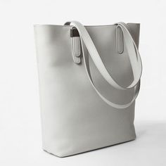 10 Fun Tote Bags We Love-Cute and Colorful Totes for Women--EVERLANE PETRA MAGAZINE TOTE-Opt for Everlane's pale gray magazine tote for subtle color that still goes with everything.  Visit redbookmag.com to find the perfect tote for you.