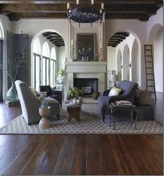 i like how the ceiling matches the floor & not mix match.. love the dark colors paired with white walls