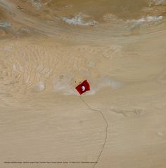 """""""Tunisia"""" the northernmost country in Africa on 05/02/2015 makes a record and enters in the Guinness book of world records for making the largest flag in the world, whose size is 104,544 m2, weighted 12.6 tonnes and consumed 80 km fabric. This movement was captured by Pléiades -1A satellite. Image © Airbus Defence and Space 2017. SATPALDA Geospatial Services is a privately owned company and authorised reseller of satellite imagery of Airbus Defence and Space 2017. http://www.satpalda.com"""