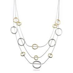 Hugs and Kisses $24. Gold, rhodium, and rose metal loops create an illusion look on this 3-row necklace. We love it's light and airy feel!